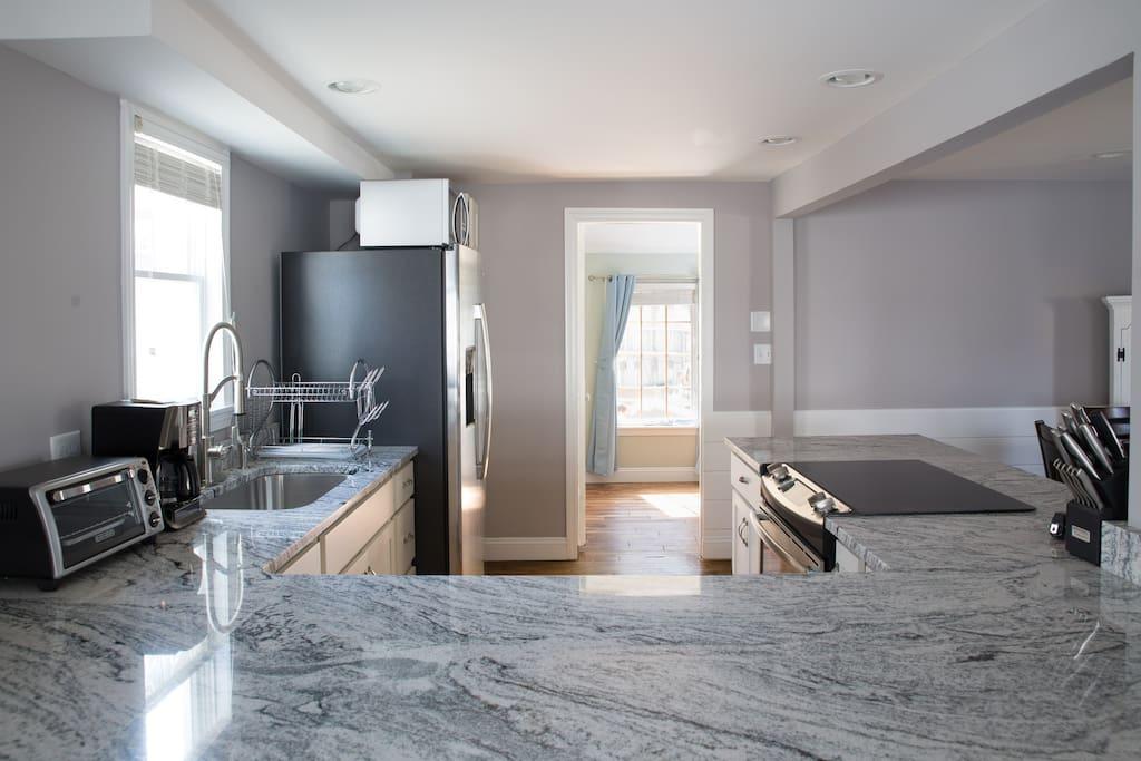 Italian Granite Kitchen with Stainless Steel Appliances