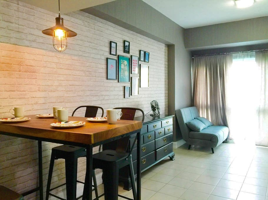 Panoramic view of dining area and living area
