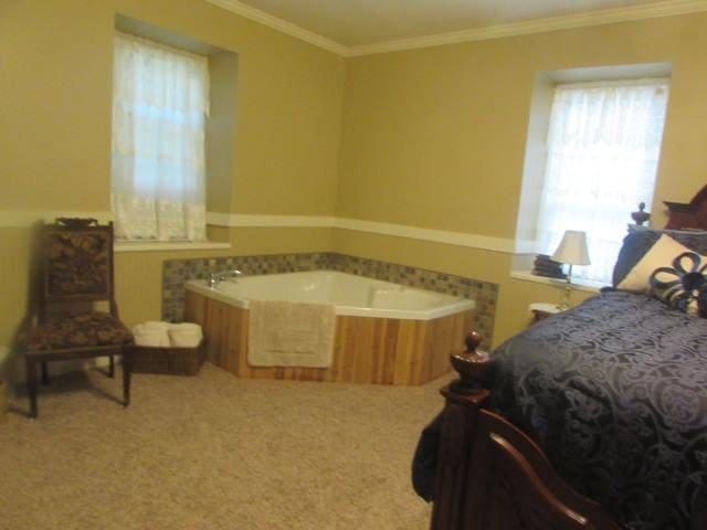 corner whirlpool tub for two, bath salts in room.