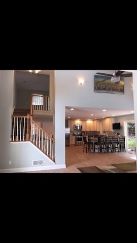 This is the view as you enter the front door-great open floor plan and vaulted ceiling with view of upper level loft!