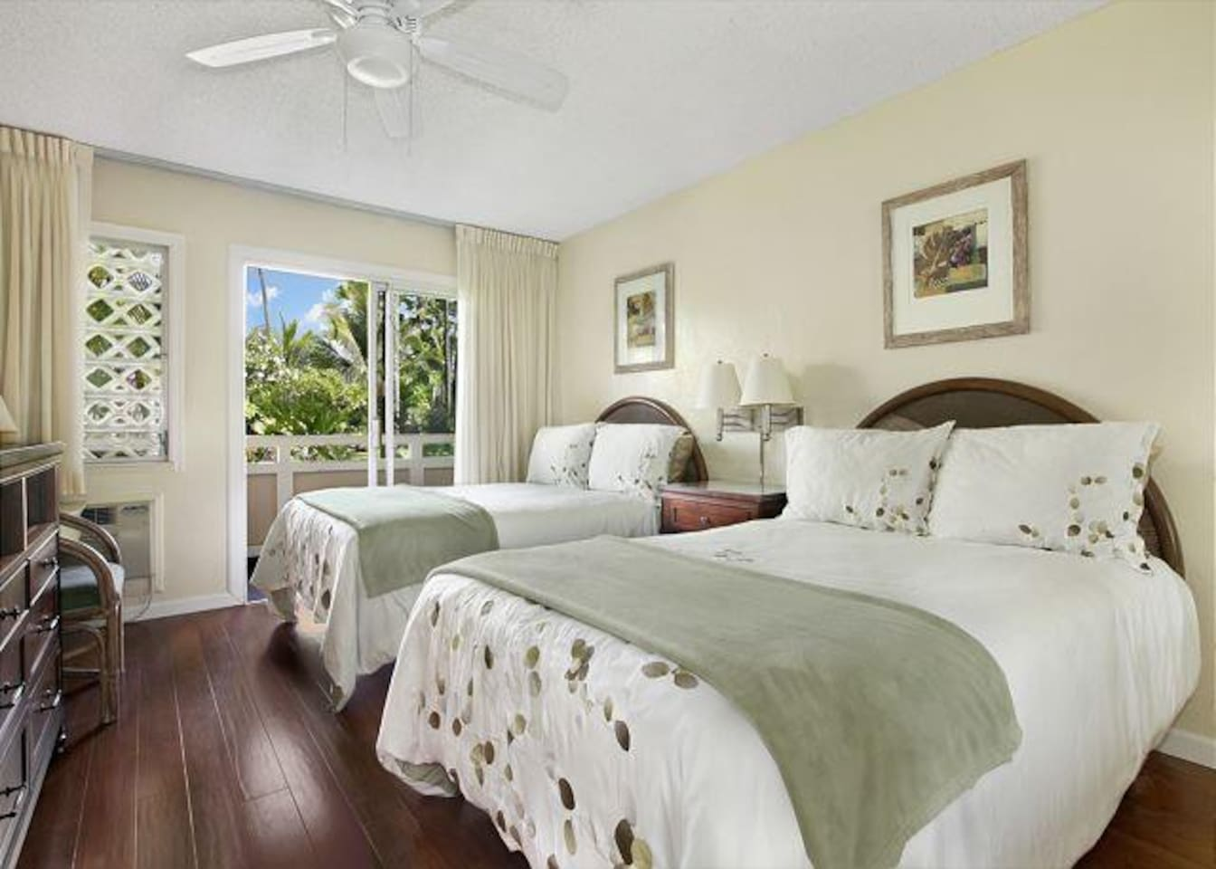Inviting, fresh, bedroom with 2 double beds and sliding doors out to lanai/deck with  beautiful garden & pool views. Luxurious high thread count linens and rosewood furniture