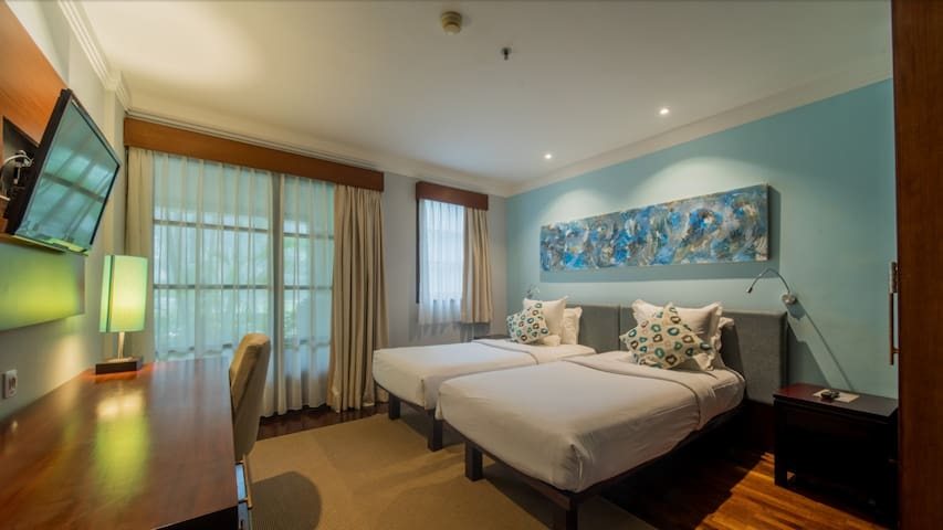 Second bed room with twin bed, has a view to the garden.