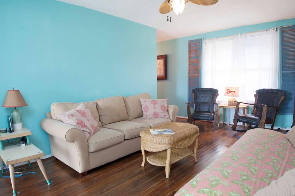 Another view of living room showing sofa in two bedroom side.