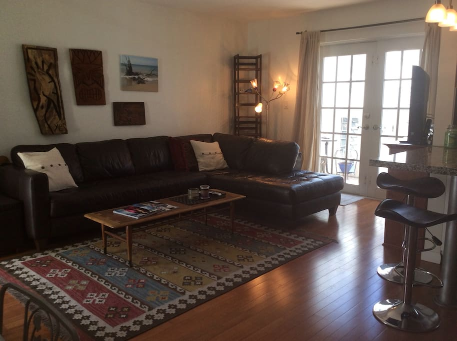Living room with a sofa accommodating 2 people