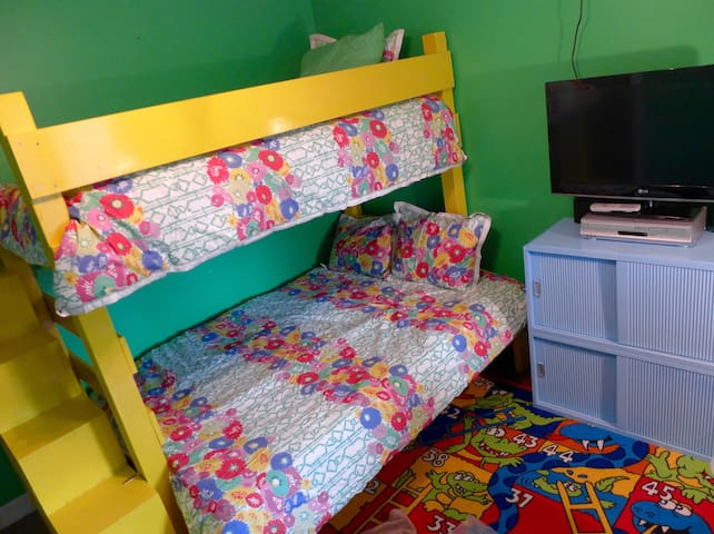 Colorful room for kids or anyone has twin-over-full bunkbed to sleep 3 + Pack 'n Play. Plenty of Disney and other kids videos for TV.