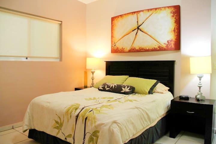 Queen bed in second bedroom.