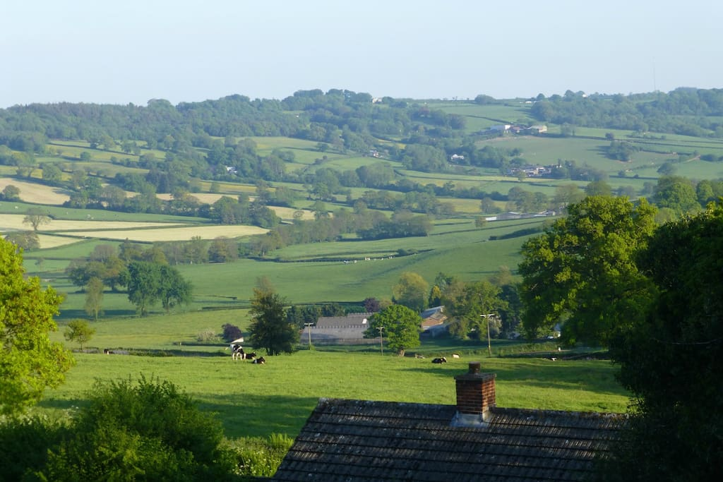 The view from Otter Rise, the cottage roof is in foreground