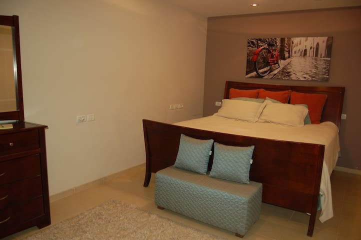 Main bed room, very large California king bed. Interior by a decorator.
