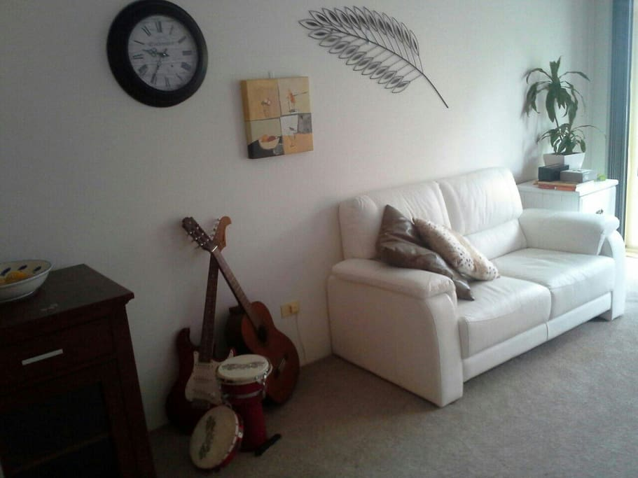 My lounge room, you can play the guitar!