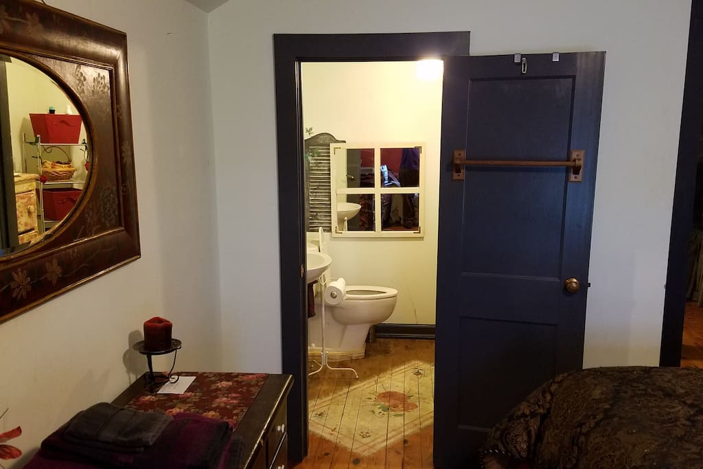 The half bath is part of the Red room
