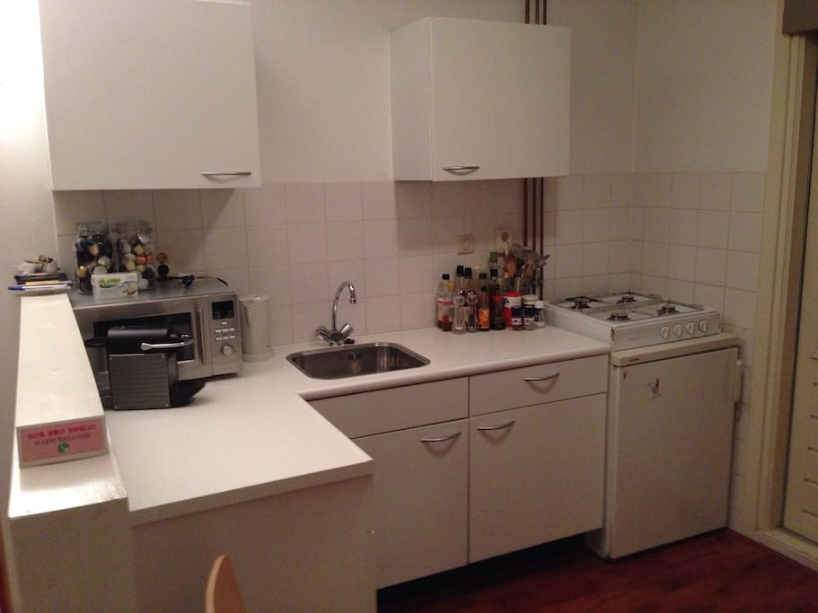 Kitchen with a fridge, microwave, good cooking facilities and a nespresso coffee machine.