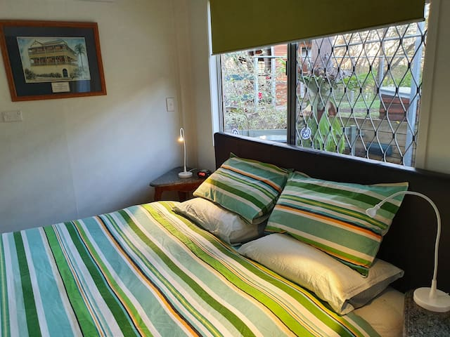 Comfortable, king size bed, with bright airy windows. Air conditioning makes for a welcome, cool retreat in summer and a cozy nook in winter.