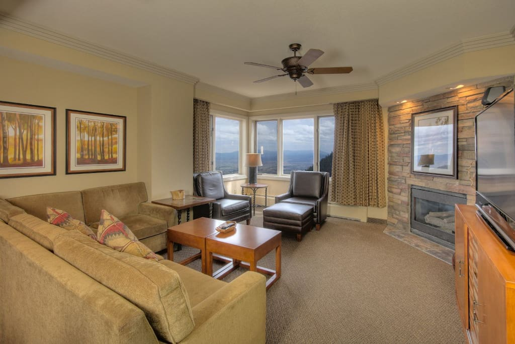 Newly remodeled Plaza unit Living Room with a fireplace, big screen TV, and view of Carson Valley.