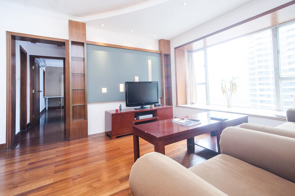 spacious shared living room with LED TV with numerous movies and TV series