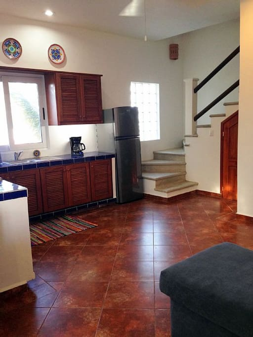 Penthouse Kitchen and stairs to third floor Bedroom and Deck