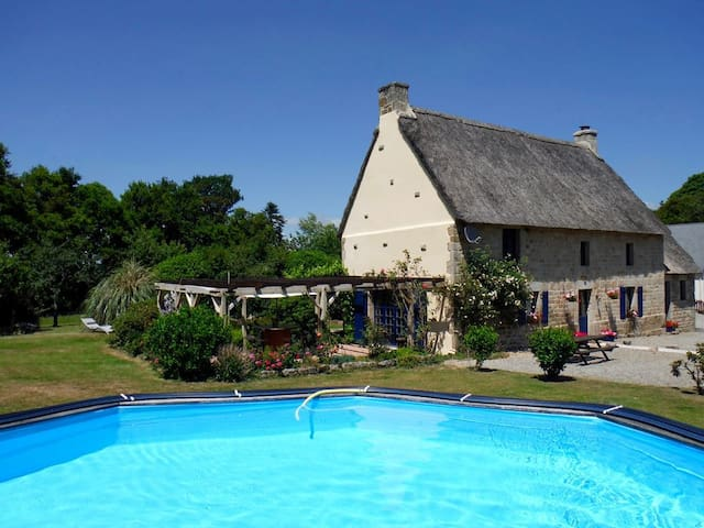 Beautiful thatched 4 bedroomed house with pool.