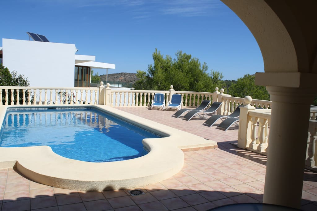 Pool with lots of terracing and loungers supplied.