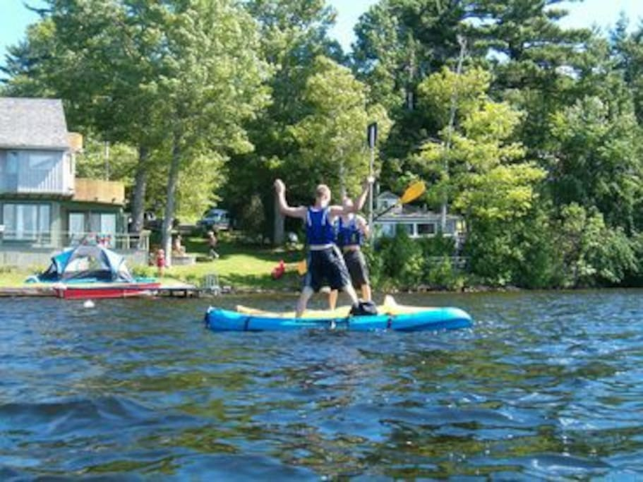 The cottage is tucked into the trees directly on the lake -- have fun kayaking or swimming right outside your door!