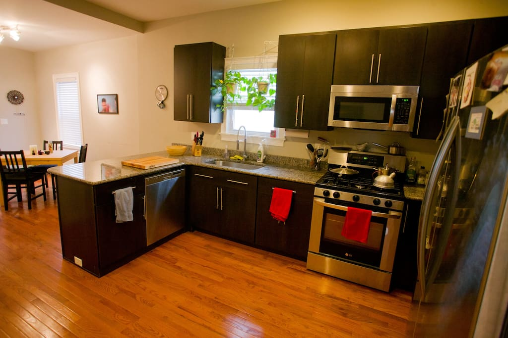 Renovated kitchen with granite countertops, stove, dishwasher, etc.