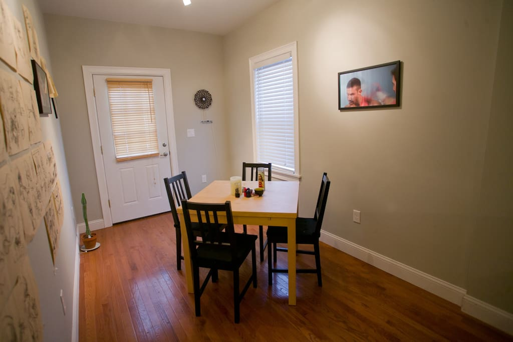 Dining area with door to backyard.