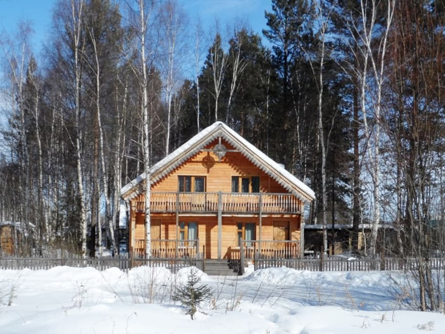 Siberian wooden house on lake Baikal