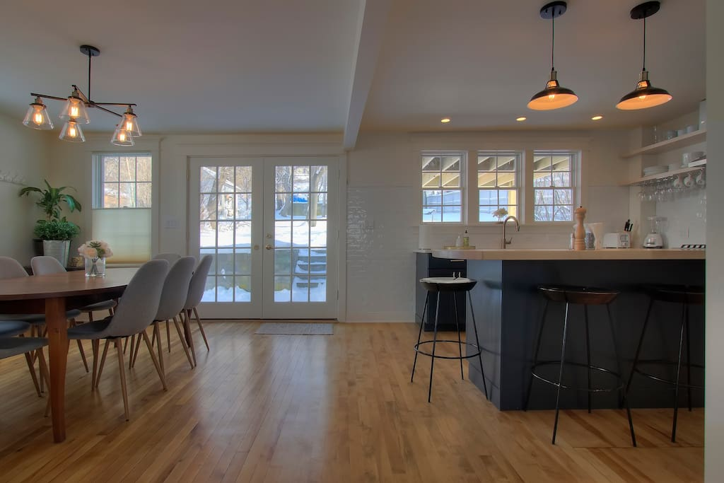View of the kitchen/dining room showing double french doors out to the back yard.