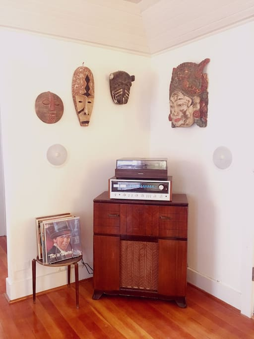 Vintage pioneer stereo system with inset wall mounted speakers. Lots of interesting vintage Vinyl to chose from.   African and Balinese masks