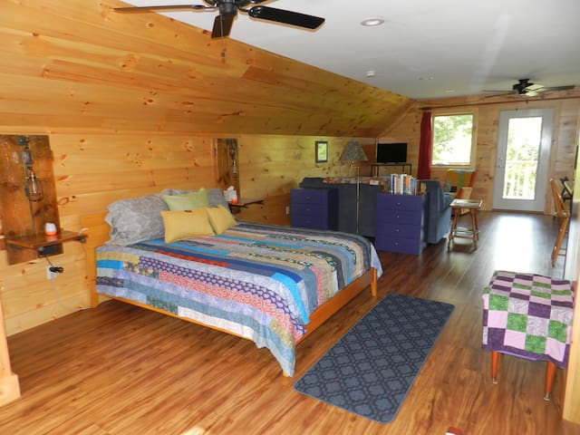The wide open loft, viewed from the entrance, has a very comfy queen size bed.