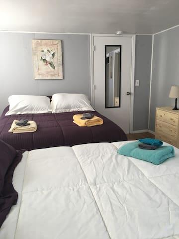 First floor. 2 queen size beds.