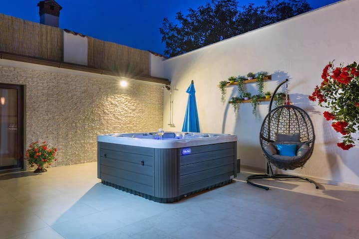 House with hot tub and fanced garden