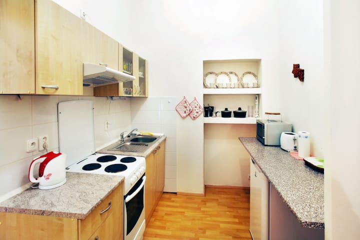 there are oven, toaster, coffee machine, kettle, cooker and microwave oven