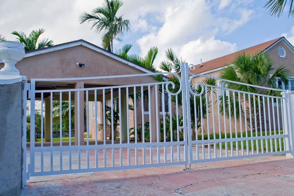 Gated entry showing covered car garage