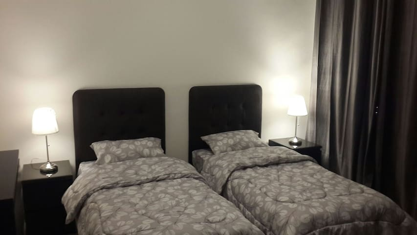 2nd bedroom with 2 separate beds that's fits two persons comfortably