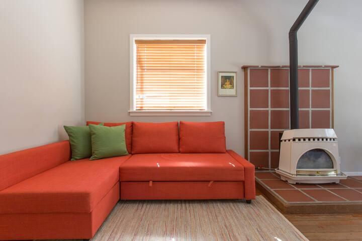 Sofa that converts to sleeper.  Bedding under cushion.