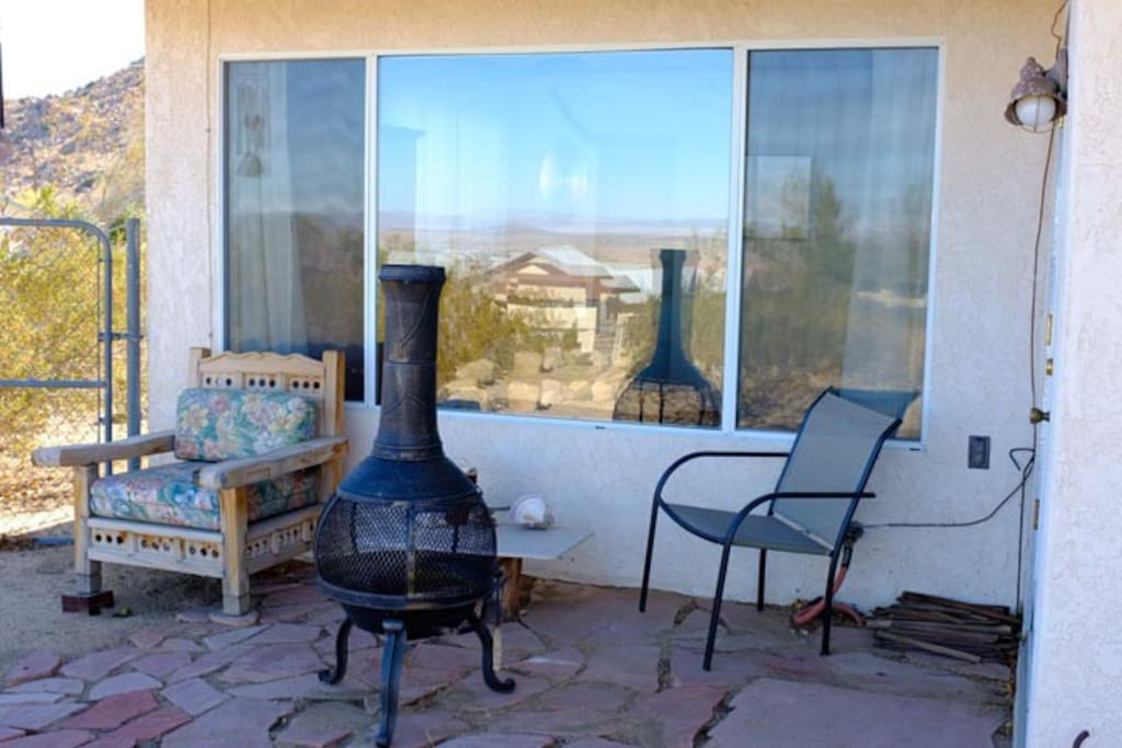 Backyard chiminea and chairs, with view that faces North.