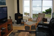 Livingroom with woodstove, flat screen tv and DVD library.  Satellite cable service and free wi-fi!
