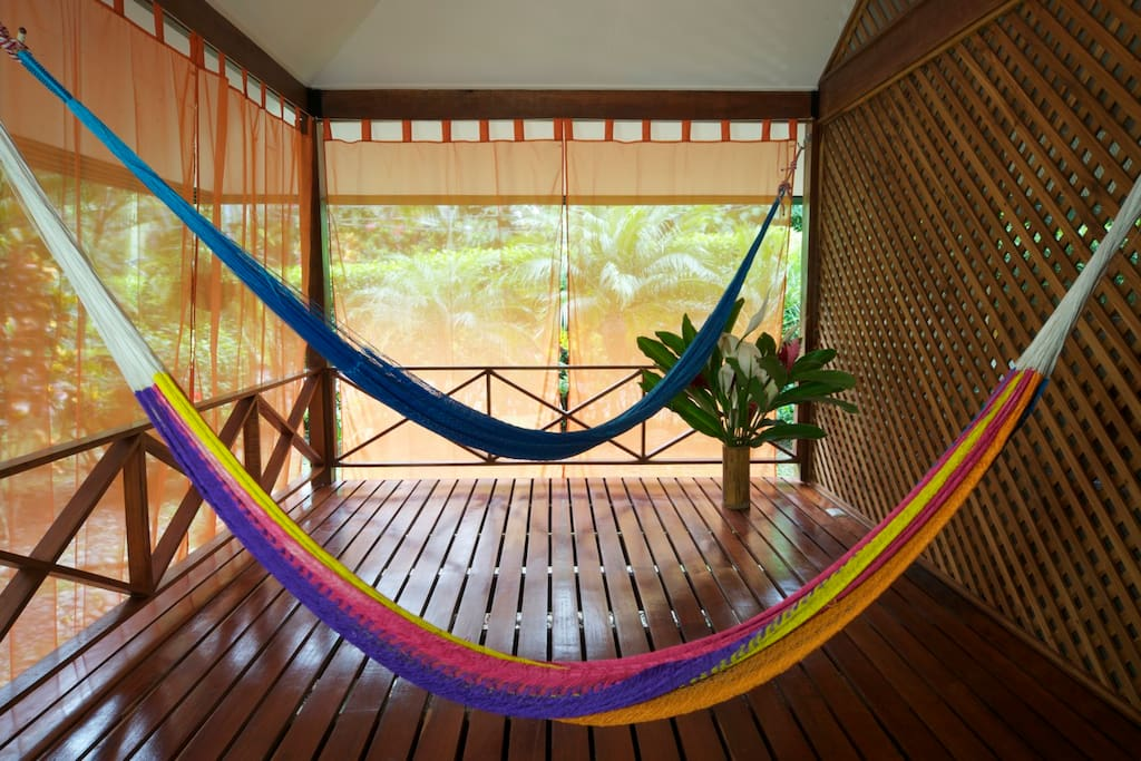 Spacious porch with hammocks.