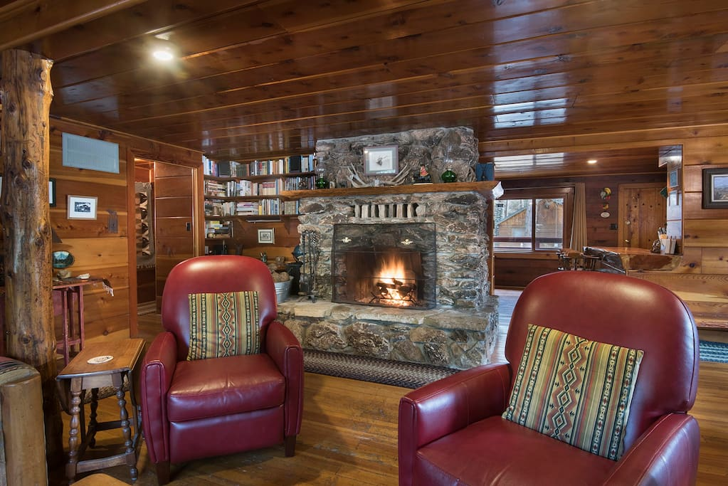 Relax in the living room and warm yourself next to the river rock fireplace.