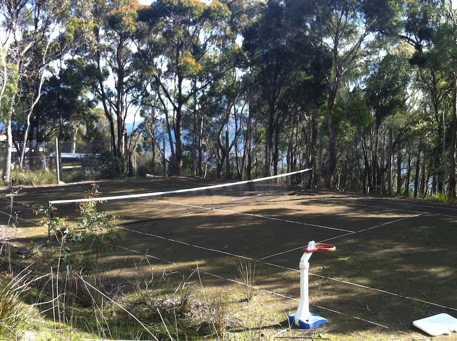 Play tennis on our rustic clay tennis court