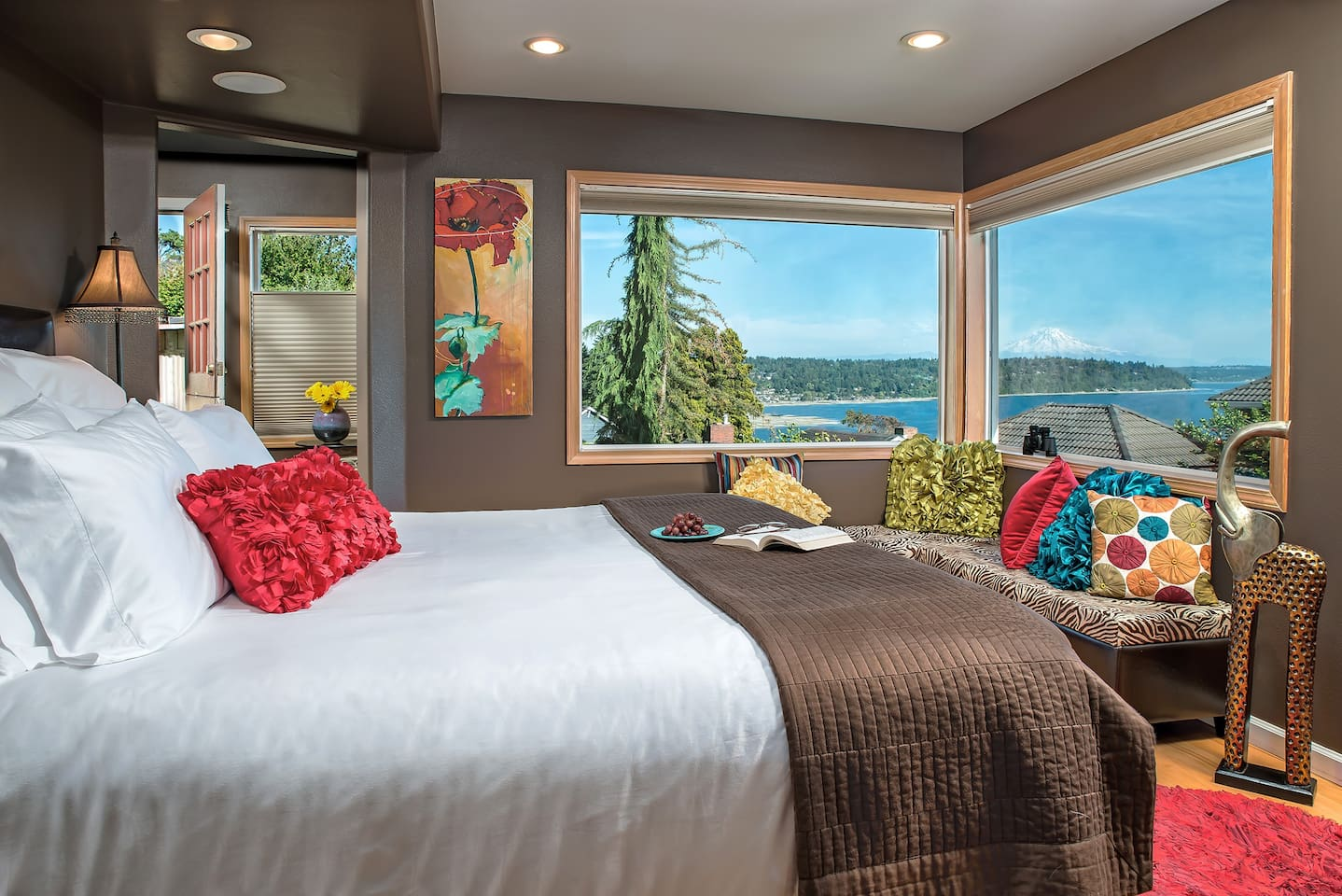 Cottage Bedroom with a view of the Puget Sound and Mount Rainier. Cal. King Bed