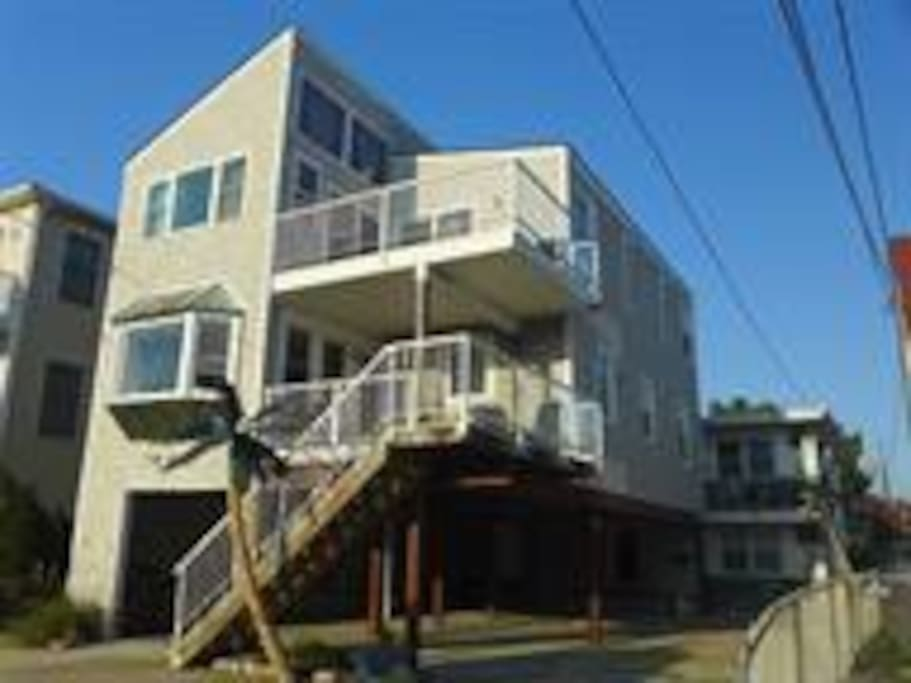 2 decks on front of house overlooking street and views to beach