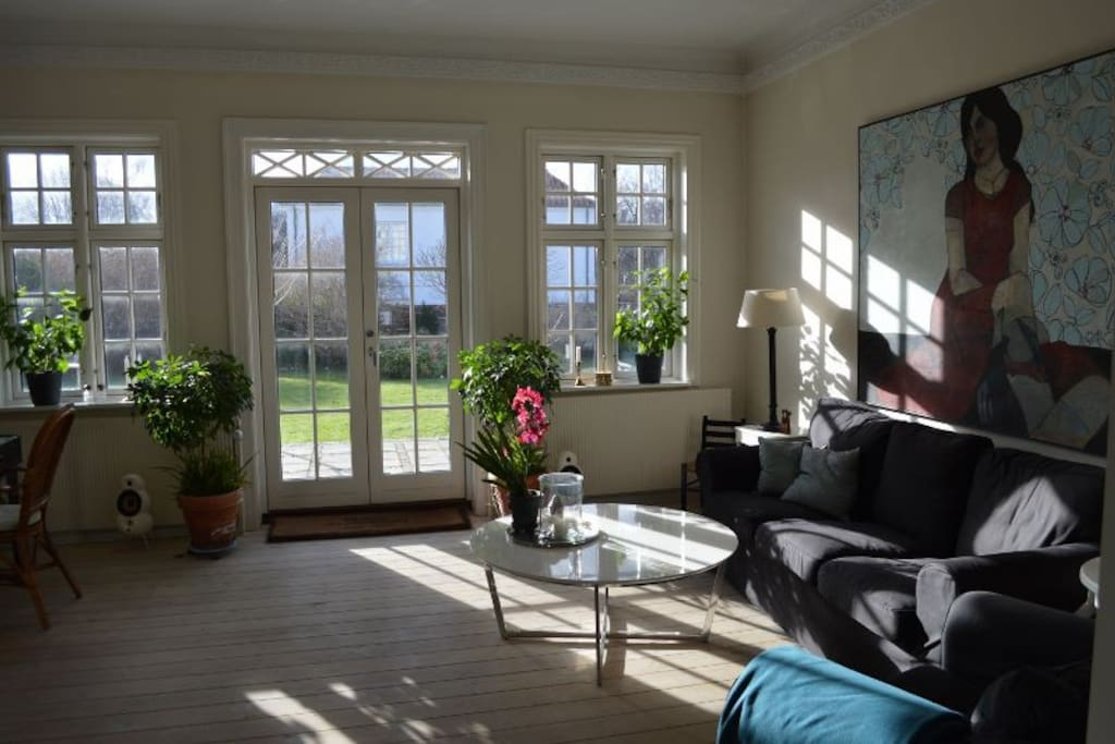 Livingroom with access to deck and garden