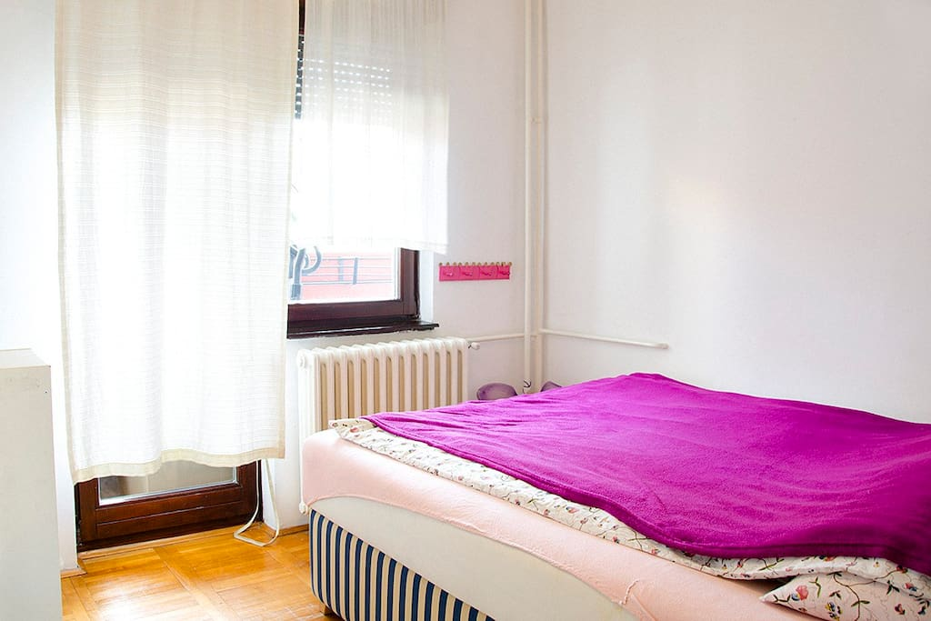 Sunny bedroom with large and extremely comfortable double bed.
