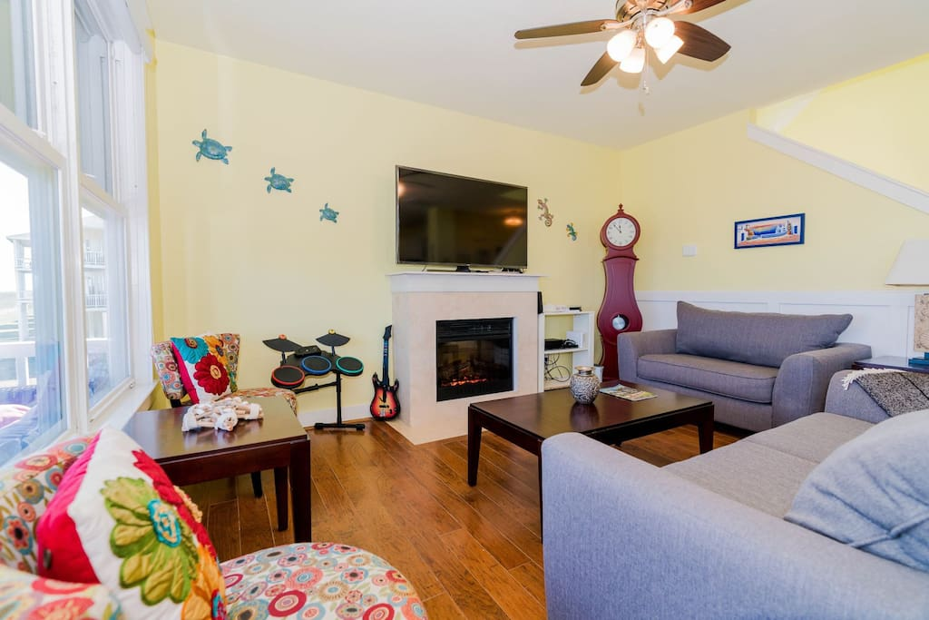 Living area offers a fireplace, large flat screen TV & plenty of video game systems for kids in case of a rainy day