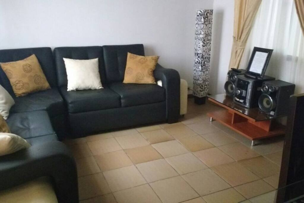 Beautiful black three piece sofa and stereo