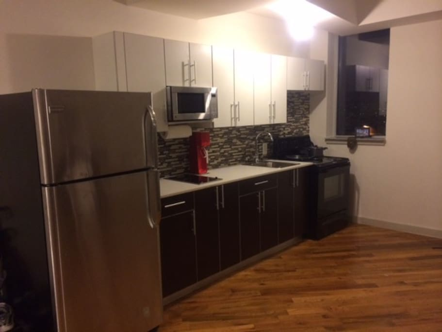 Full electric stove, microwave, Full size refrigerator, dishes with utensils.