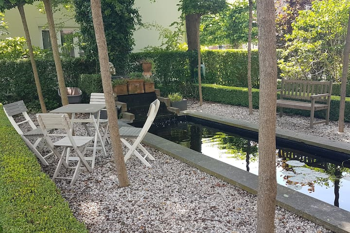 Terrace under the trees by the koi pond