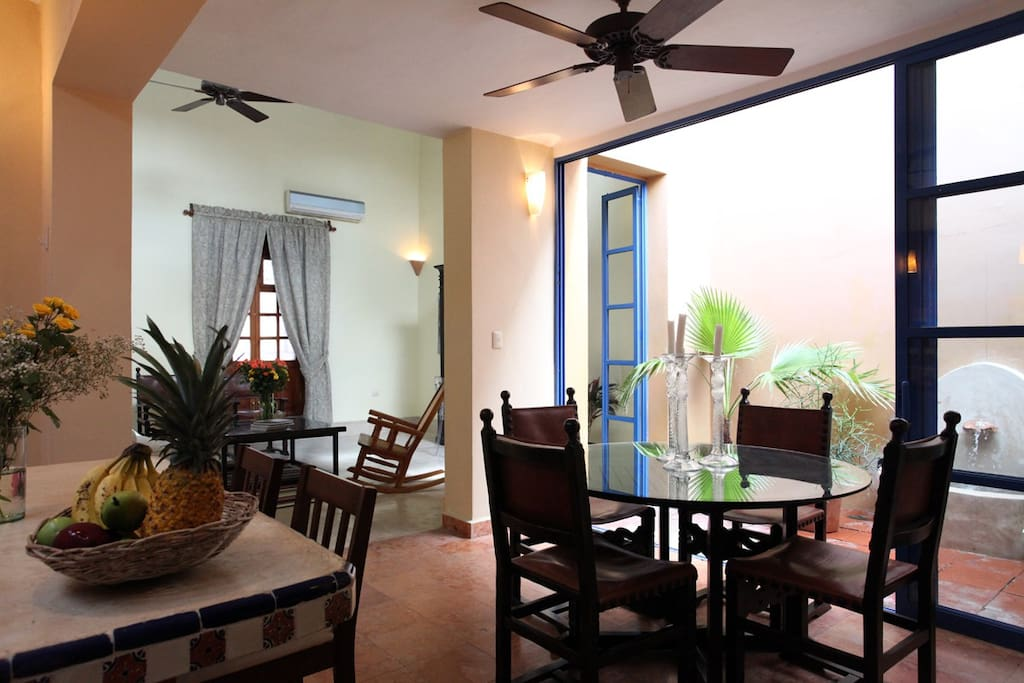 Light-filled living and dining area that both open to a small patio...