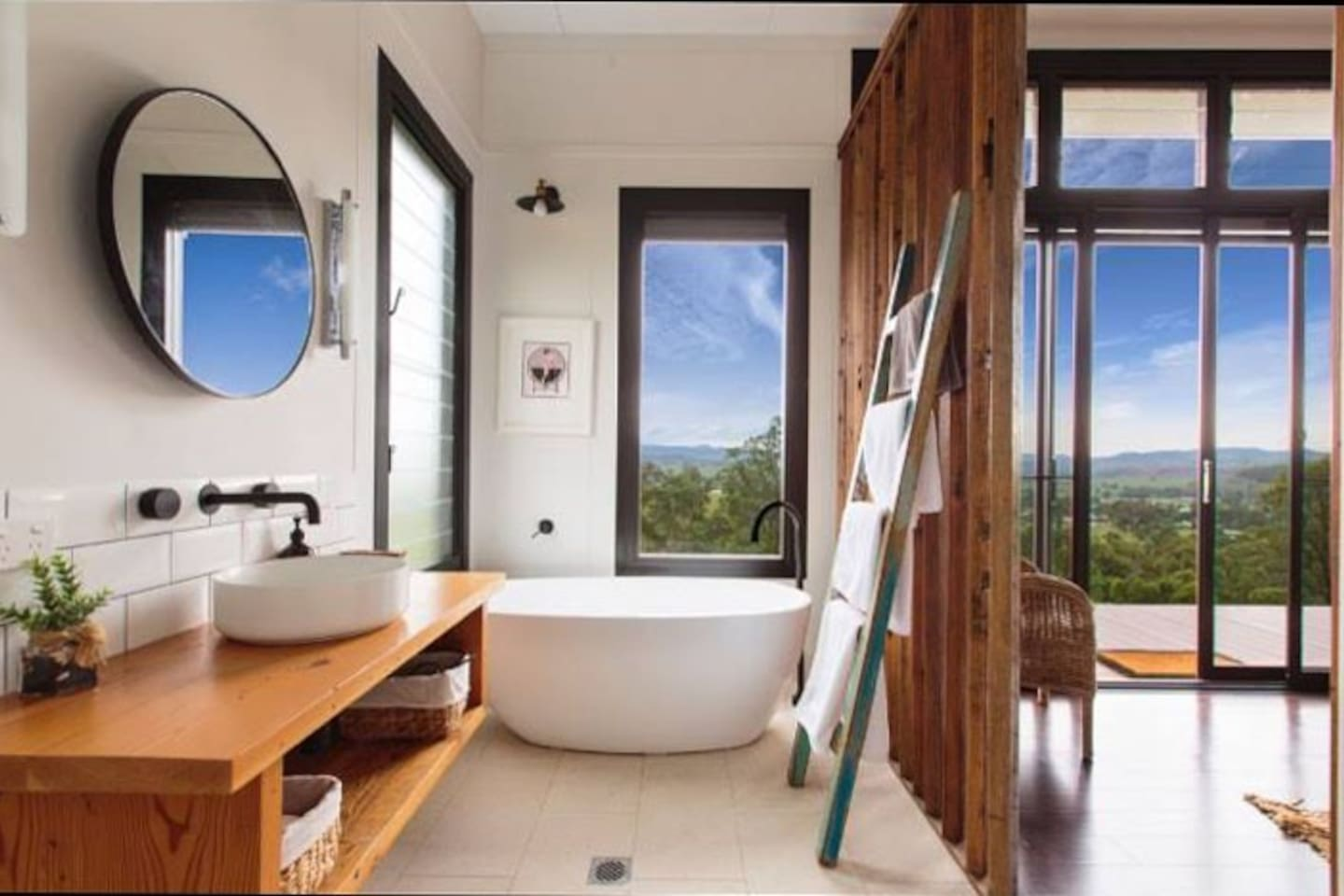 The Eco-Cabin's beautiful bathroom has a bath and shower and outstanding views