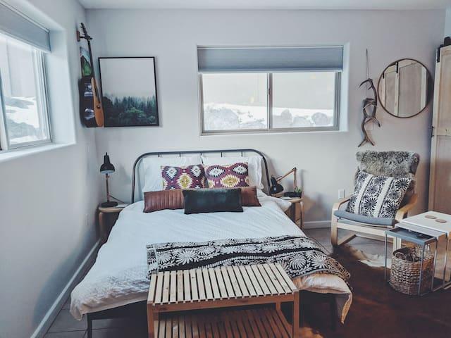Queen bed with down duvet